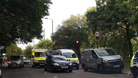 Emergency services at the scene in Green Lanes where a road sweeper was knocked over by a moped. Pic