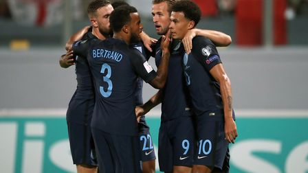 England's Harry Kane (second, right) celebrates scoring his side's first goal of the game against Ma