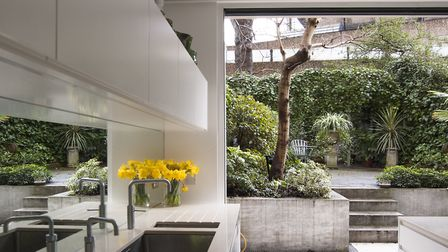 The tiled floor runs continuously through to courtyard dining area forming a harmonious relationship