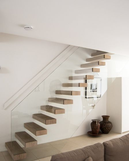 The open tread staircase provides a focal point for the ground floor living space