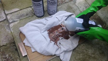 This t-shirt began to discolour and turn brown as soon as the strong acid drain unblocker was poured
