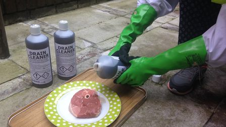 During a test, drain unblocker containing 96 per cent proof sulphuric is poured onto a lamb steak. P