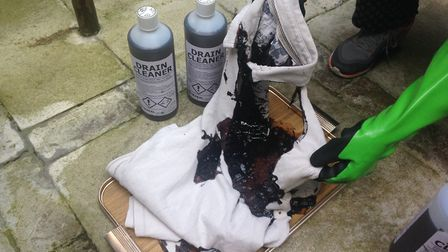 The t-shirt was badly scorched and burned and completely dissolved in places when strong acid drain