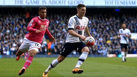 AFC Bournemouth's Joshua King (left) chases Tottenham Hotspur's Kevin Wimmer during the Barclays Pre