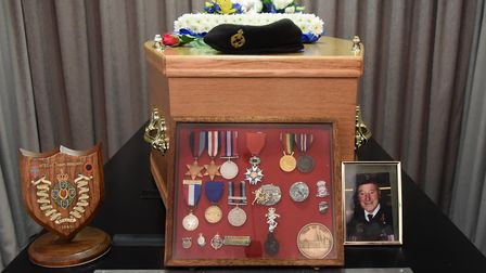 Normandy veteran Peter Hemp's medals by the coffin at his funeral at the Waveney Memorial Park at El