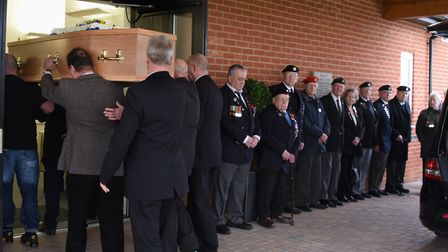 Veterans and members of the Norwich and District Normandy Veterans Association make a guard of honou