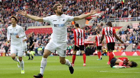 Fernando Llorente celebrates scoring for Swansea City during the Premier League match at the Stadium