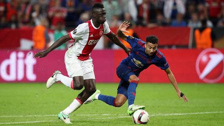 Manchester United's Jesse Lingard goes through on goal but is tackled before Ajax's Davinson Sanchez