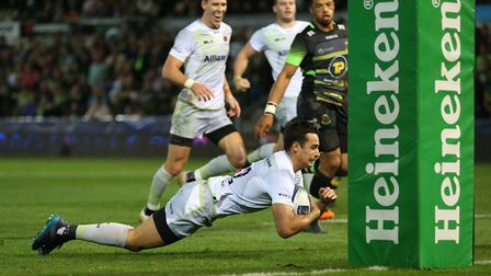 Alex Lozowski of Saracens crosses for a try against Northampton Saints in the European Champions Cup