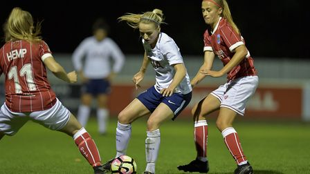 Sophie Mclean, of Tottenham Hotspur Ladies, looks to keep the ball away from her Bristol City rivals