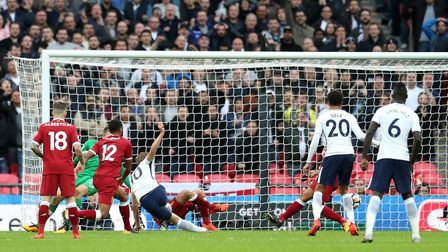 Tottenham Hotspur's Harry Kane (centre) scores his side's fourth goal of the game during the Premier