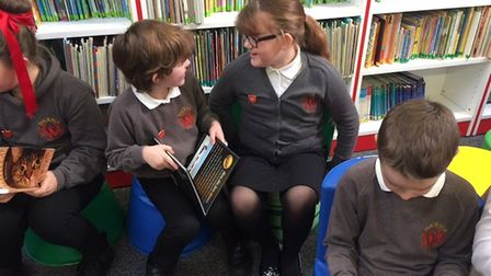 Children enjoy reading in the new library at Phoenix St Peter Academy in Lowestoft. Pictures: Courte