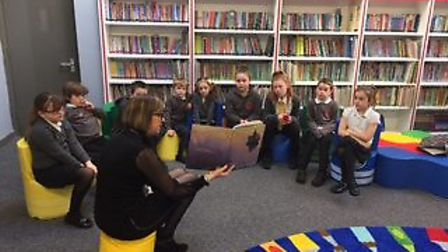 The first book is read at the new library at Phoenix St Peter Academy in Lowestoft. Pictures: Courte