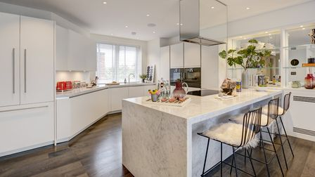 Kitchen area featuring Carrara marble work surfaces
