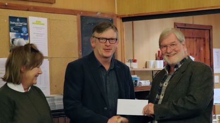 Mike Powell-Evans presents a cheque to Tessa Barne and Doeke Dobma, on behalf of Clinks Care Farm. P