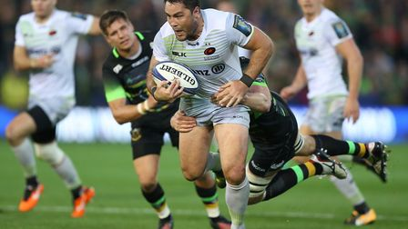 Brad Barritt of Saracens is tackled during the European Champions Cup match at Northampton Saints (p