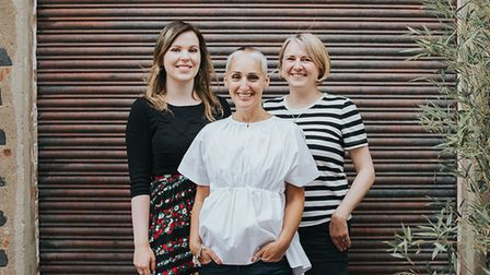 Sarah Burns (centre) with her colleagues. Picture: Prizeology