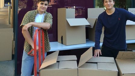 Joshua Naftalin (left) and Benjamin Byre ready to deliver some of the 33 boxes the school produced f