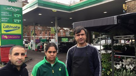 Nicky Patel (middle) has launched a petition to save the BP garage Picture: Linda Grove