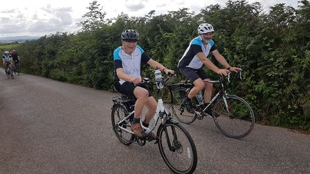Norman cycling alongside his son Tom in Devon. Picture: NORMAN FRANKLIN