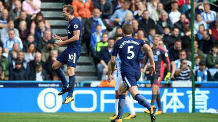 Tottenham Hotspur's Harry Kane celebrates scoring his side's third goal at Huddersfield (pic Nigel F