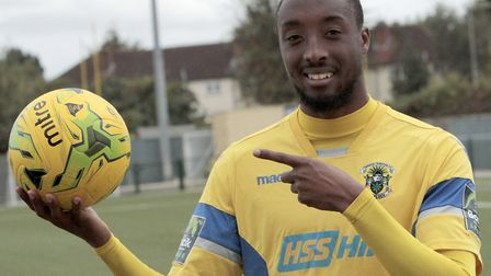 Ralston Gabriel holds up the match ball after scoring a hat-trick for Haringey Borough in the FA Cup