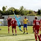 Bideford's goalkeeper tries to grab a loose ball in the area against Haringey Borough (pic: Tony Gay