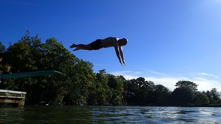 A diver using the new board at Hampstead Heath's Men's Pool
