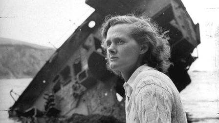 Author Daphine Du Maurier sitting by a wrecked ship. Picture: Hans Wild/The LIFE Picture Collection/