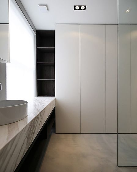 Ensuite with micro cement flooring