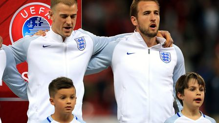 England's Joe Hart and Harry Kane sing the national anthem ahead of the match against Slovenia (pic