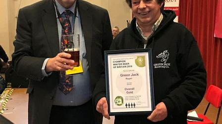 Tim Dunford recieves a winner's certificate at the Great British Beer Festival Winter in Norwich.