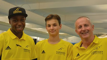 Haringey Aquatics youngster Max Green (centre), with coaches Nathan Joseph and Paul Doyle