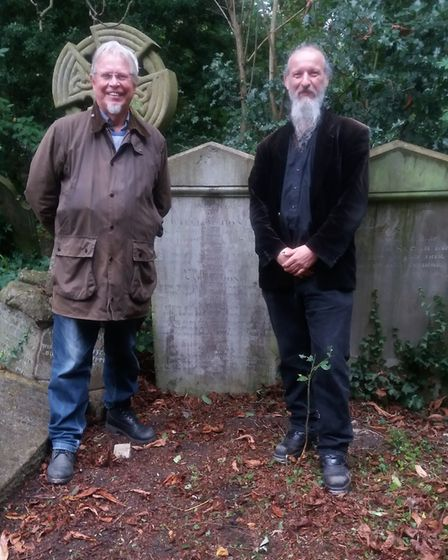 Alan Gartrell and John Baldock by William Hone's grave in Abney Park. Picture: Abney Park Trust
