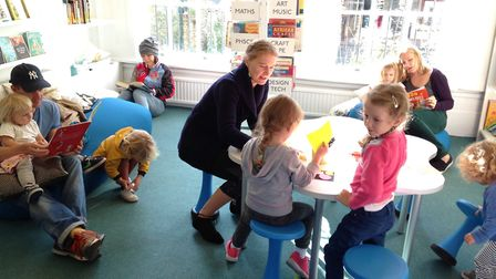 Children enjoying the refurbished library at Grasmere Primary School.