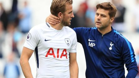 Tottenham Hotspur's Harry Kane (left) and manager Mauricio Pochettino after the final whistle at the