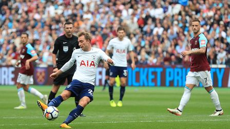 Tottenham Hotspur's Christian Eriksen (left) scores his side's third goal of the game during the Pre