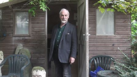 Terrence McGinity at the entrance to his shed in St John's Wood, under threat from a neighbouring de