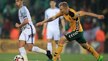 England's Harry Winks (left) and Lithuania's Ovidijus Verbickas battle for the ball during the 2018