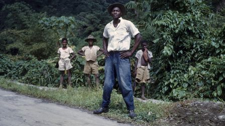 A man standing by the roadside in Dominica, circa 1966. Picture: Derek Smith.
