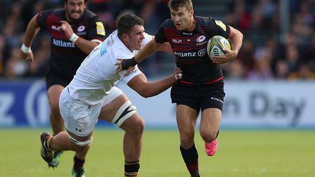 Saracens Richard Wigglesworth is tackled by Wasps Nick Isiekwe during the Aviva Premiership match at