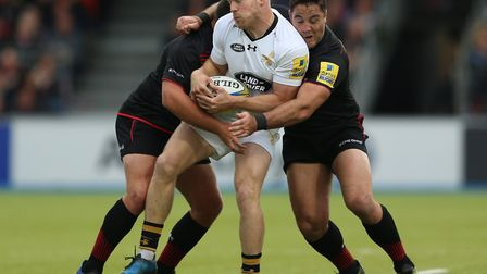 Saracens' Brad Barritt (right) tackles Wasps' Joe Simpson (pic: Nigel French/PA)