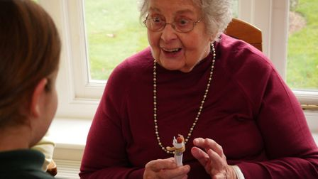 Rosemary, a resident at Broadlands Care Home, obviously delighted with the peg doll given to her by