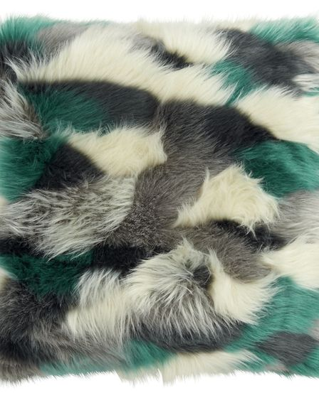 Abstract Fur Cushion, �29.50, from Marks and Spencer