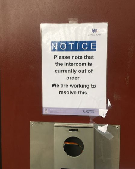 This sign was put up nine weeks after the intercom system broke, according to residents Picture: Nat