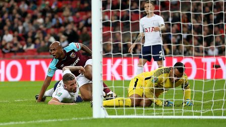 West Ham United's Andre Ayew (centre) scores his side's second goal of the game during the Carabao C