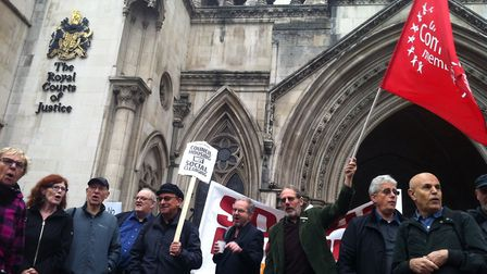 Campaigners gathered outside the Royal Courts on both days of the hearing, shouting and waving placa