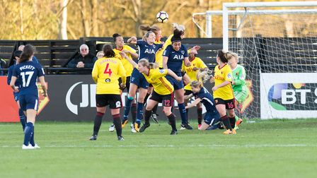 Tottenham Hotspur Ladies' Wendy Martin goes up for a header against a lot of Watford Ladies counterp