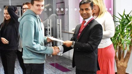 A Care Academy student receives his bursary cheque at the presentation. Picture: Courtesy of Kingsle