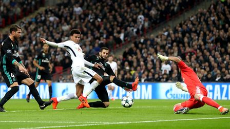 Tottenham Hotspur's Dele Alli (centre) scores against Real Madrid in the Champions League at Wembley